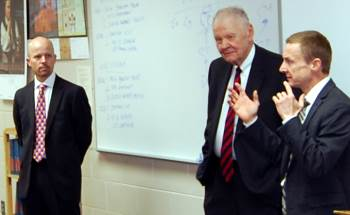 Chief Justice VandeWalle and Justices  Tufte and Jensen explained an issue to a class of students.