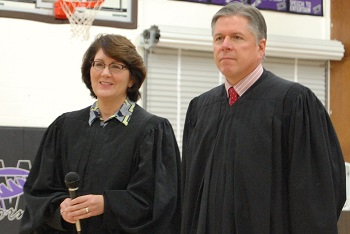 Justices Lisa Fair McEvers and Dan Crothers listen to student questions after the argument. Students from Harvey, Rugby, Anamoose-Drake, and Fessenden-Bowdon attended the session.