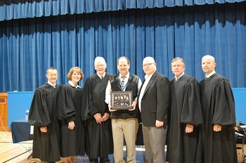 A picture of the Court was presented to Dr. Mike  Nygaard, Principal, and Mr. Frank Egan, Instructor.