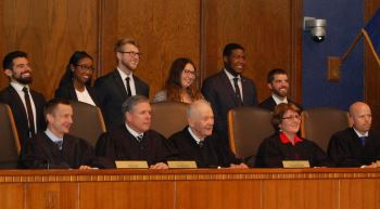 The Moot Court Board  including Peter Aiello, Olivia Jureidini, Corey Haller, Montana Funk, Ian  Duncan and Cole Johnston posed with the Court.