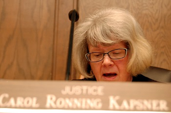 Justice Carol Kapsner questions Johnston during the arguments.