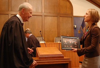 Chief Justice VandeWalle presented a photo of the Court to UND School of Law Dean Kathryn Rand after the arguments.